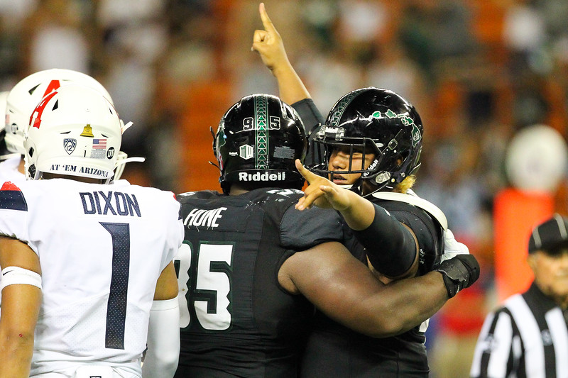 Hawaii defensive lineman Manly Williams celebrates his game-saving tackle of Arizona's Khalil Tate at the 1 yard line as time expires at Aloha Stadium on August 24, 2019, in Honolulu, Hawaii.