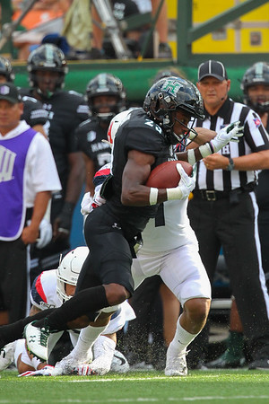 Hawaii wide receiver Jared Smart fights for extra yards against the Arizona Wildcats at Aloha Stadium on August 24, 2019, in Honolulu, Hawaii.