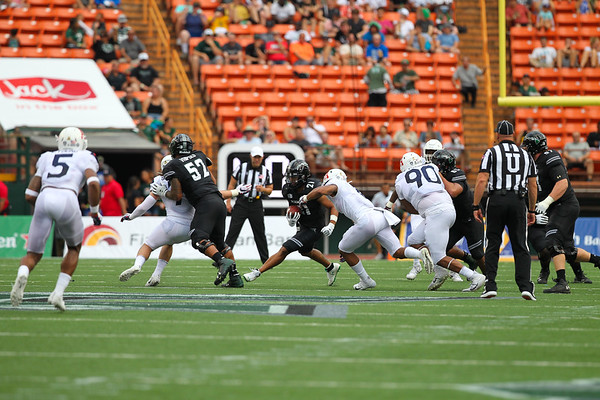 Hawaii running back Fred Holly III (21) rushes for a gain against the Arizona defense at Aloha Stadium on August 24, 2019, in Honolulu, Hawaii.