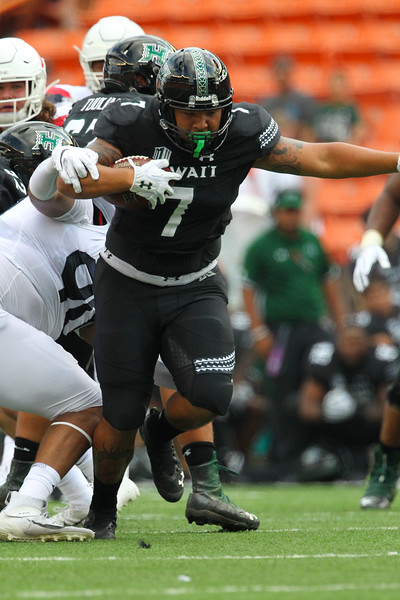 Hawaii running back Dayton Furuta runs for a gain against the Arizona Wildcats at Aloha Stadium on August 24, 2019, in Honolulu, Hawaii. Furuta rushed for 42 yards and a touchdown in Hawaii's 45-38 victory.