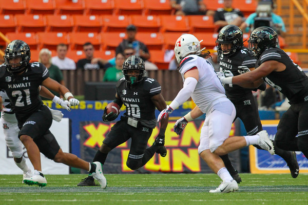 Hawaii receiver Maurice Stovall (10) returns the kickoff against Arizona at Aloha Stadium on August 24, 2019, in Honolulu, Hawaii.