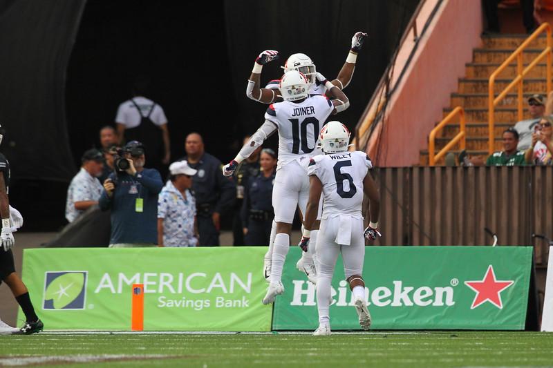 Arizona celebrates a second quarter touchdown against Hawaii at Aloha Stadium on August 24, 2019, in Honolulu, Hawaii.