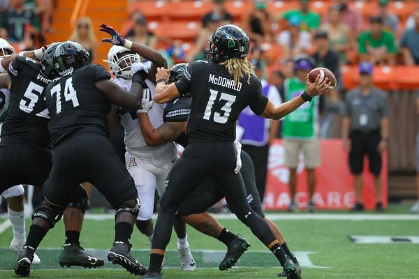 Hawaii quarterback Cole McDonald launches a pass against Arizona at Aloha Stadium on August 24, 2019, in Honolulu, Hawaii.