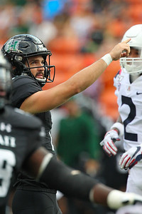 Hawaii kicker Ryan Meskell watches his extra point attempt sail through the uprights against the Arizona Wildcats at Aloha Stadium on August 24, 2019, in Honolulu, Hawaii.