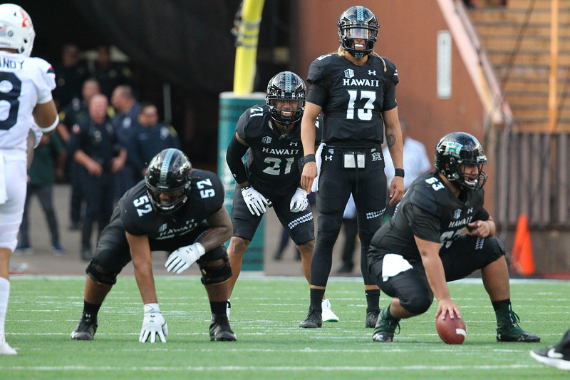 Hawaii quarterback Cole McDonald (13) stands pre-snap during second quarter action against Arizona at Aloha Stadium on August 24, 2019, in Honolulu, Hawaii.