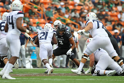 Hawaii defensive back Kalen Hicks (3) stops Arizona running back J.J. Taylor (21) for no gain during first quarter action at Aloha Stadium on August 24, 2019, in Honolulu, Hawaii.