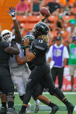 Hawaii quarterback Cole McDonald launches a pass against Arizona at Aloha Stadium on August 24, 2019, in Honolulu, Hawaii.