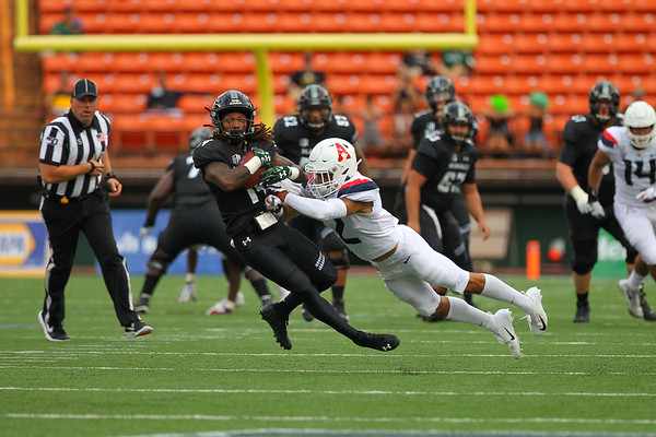 Arizona cornerback Lorenzo Burns (2) hits Hawaii receiver James Phillips (14) at Aloha Stadium on August 24, 2019, in Honolulu, Hawaii.
