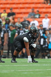 Hawaii offensive lineman Solo Vaipulu gets in his stance against the Arizona Wildcats at Aloha Stadium on August 24, 2019, in Honolulu, Hawaii.