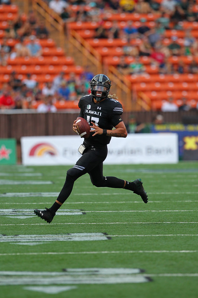 Hawaii quarterback Cole McDonald (13) scrambles from Arizona at Aloha Stadium on August 24, 2019, in Honolulu, Hawaii.