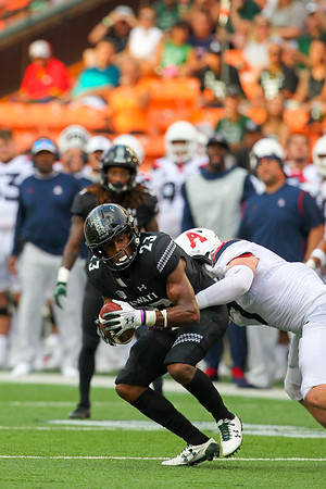 Hawaii receiver Jared Smart (23) completes a 10 yard reception against Arizona at Aloha Stadium on August 24, 2019, in Honolulu, Hawaii.