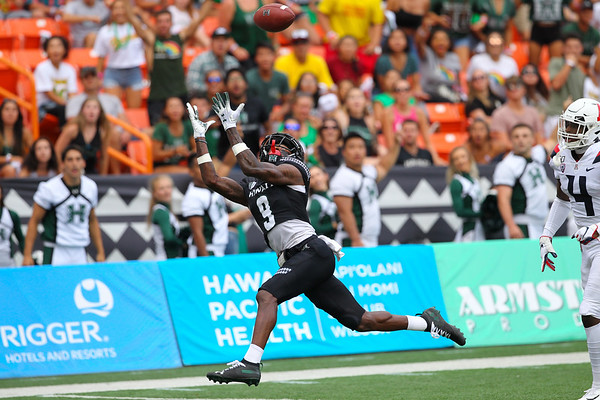 Hawaii receiver Jojo Ward catches a 39 yard touchdown pass from Cole McDonald to put Hawaii up, 14-0, in the first quarter against the Arizona Wildcats at Aloha Stadium on August 24, 2019, in Honolulu, Hawaii.