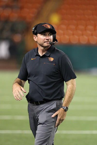 Oregon State head coach Jonathan Smith checks the scoreboard during the football game against Hawaii at Aloha Stadium on September 7, 2019, in Honolulu, Hawaii.