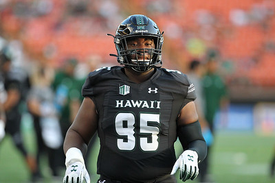 Hawaii defensive lineman Kendall Hune takes the field against Oregon State at Aloha Stadium on September 7, 2019, in Honolulu, Hawaii.
