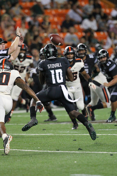Hawaii receiver Maurice Stovall attempts to catch a tipped pass against Oregon State at Aloha Stadium on September 7, 2019, in Honolulu, Hawaii.