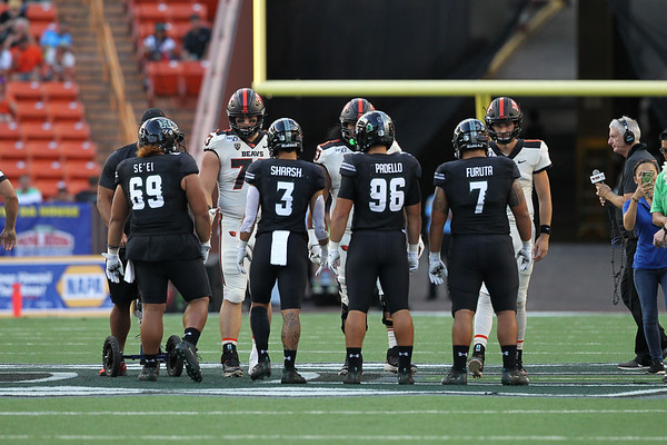Team captains from Oregon State and Hawaii meet at midfield at Aloha Stadium on September 7, 2019, in Honolulu, Hawaii.