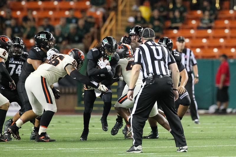 Hawaii running back Miles Reed rushes up the middle against Oregon State at Aloha Stadium on September 7, 2019, in Honolulu, Hawaii.