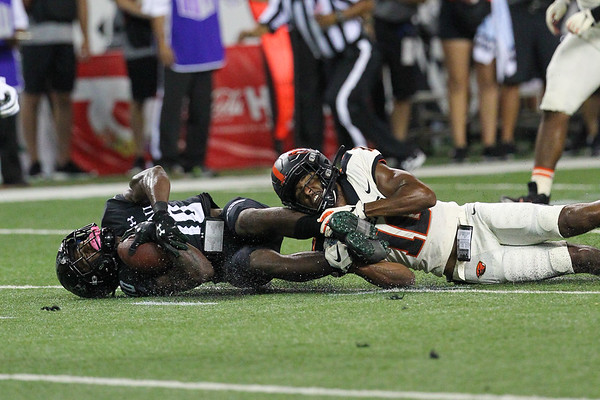 Hawaii receiver Maurice Stovall is brought down by an Oregon State defender at Aloha Stadium on September 7, 2019, in Honolulu, Hawaii.