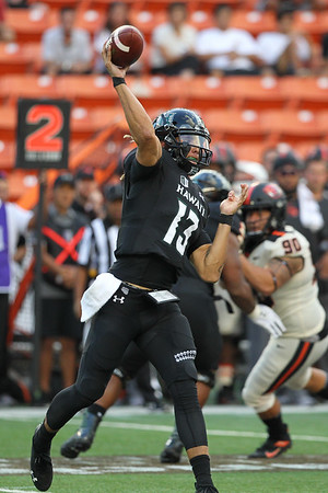 Hawaii quarterback Cole McDonald throws a pass against the Oregon State defense at Aloha Stadium on September 7, 2019, in Honolulu, Hawaii.