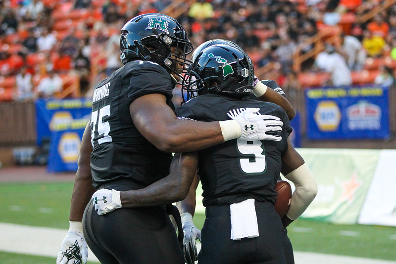 Hawaii wide receiver JoJo Ward (9) is congratulated by teammates after scoring a touchdown against Oregon State at Aloha Stadium on September 7, 2019, in Honolulu, Hawaii.