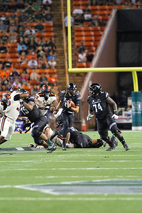 Hawaii quarterback Cole McDonald rushes for 11 yards against Oregon State in the second quarter at Aloha Stadium on September 7, 2019, in Honolulu, Hawaii.