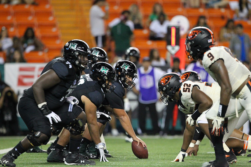The Hawaii offense faces off against the Oregon State defense in the fourth quarter at Aloha Stadium on September 7, 2019, in Honolulu, Hawaii.
