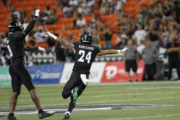 Hawaii defensive backs Eugene Ford (8) and Kai Kaneshiro (24) celebrate a fourth down stop against Oregon State at Aloha Stadium on September 7, 2019, in Honolulu, Hawaii.