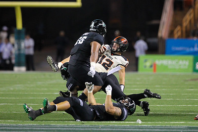 Oregon State quarterback Jack Colletto (12) is brought down by the Hawaii defense at Aloha Stadium on September 7, 2019, in Honolulu, Hawaii.