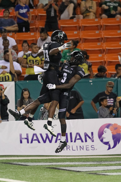 Hawaii receiver JoJo Ward (9) celebrates with teammate Jared Smart (23) after his third touchdown reception against Oregon State at Aloha Stadium on September 7, 2019, in Honolulu, Hawaii.