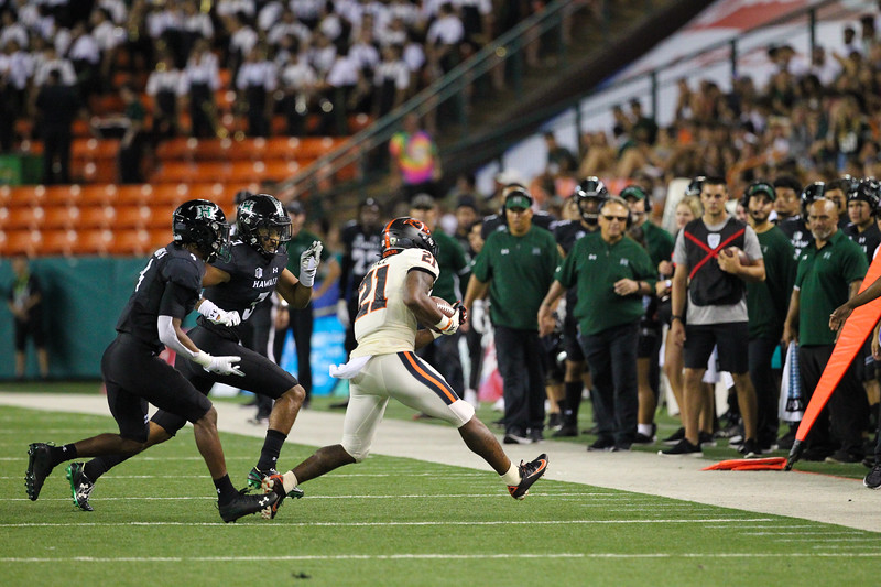 Oregon State running back Artavis Pierce rushes for a short gain against Hawaii at Aloha Stadium on September 7, 2019, in Honolulu, Hawaii.
