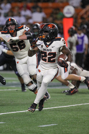 Oregon State running back Jermar Jefferson (22) rushes against Hawaii at Aloha Stadium on September 7, 2019, in Honolulu, Hawaii.