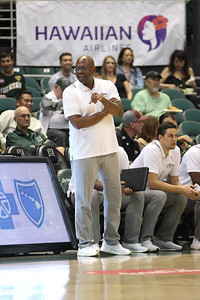 Cal Poly coach John Smith chats with the referee during a game against Hawaii at the Stan Sheriff Center, Honolulu, Hawaii on January 16, 2020.