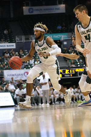 Keith Smith's (0) feet hover above the ground on this drive to the hoop at the Stan Sheriff Center, Honolulu, Hawaii on January 16, 2020.