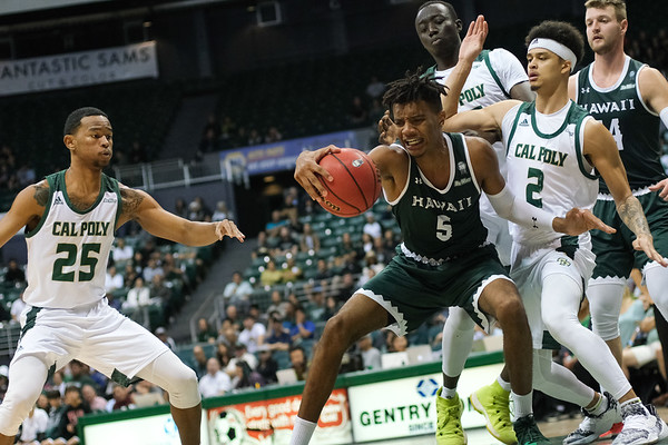 Bernardo Da Silva (5) gets physical on the post against Cal Poly at the Stan Sheriff Center, Honolulu, Hawaii on January 16, 2020.