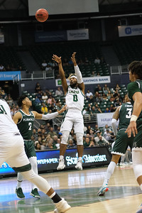 Keith Smith (0) shoots a midrange J over Justin Webster (2) at the Stan Sheriff Center, Honolulu, Hawaii on January 16, 2020.