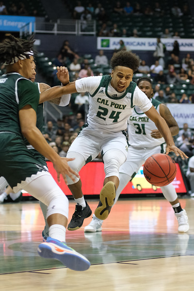 Cal Poly's Junior Ballard (24) loses the ball during a drive against Hawaii at the Stan Sheriff Center, Honolulu, Hawaii on January 16, 2020.