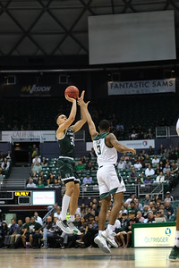 Samuta Avea shoots over Colby Rogers at the Stan Sheriff Center, Honolulu, Hawaii on January 16, 2020. Avea finished the game with 9 points.