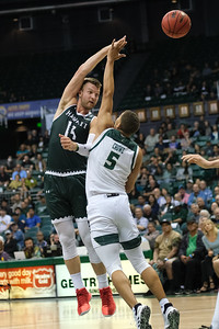 Zigmars Raimo executes a jump pass over Mark Crowe at the Stan Sheriff Center, Honolulu, Hawaii on January 16, 2020. Raimo double-doubled with 11 points and 14 rebounds but shot an inefficient 2-14 from the field.