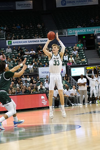 Cal Poly's Kyle Colvin (33) shoots a 3 against Hawaii at the Stan Sheriff Center, Honolulu, Hawaii on January 16, 2020. Colvin was 2-5 on three point attempts and finished with 11 points.