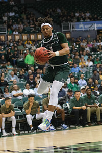 Drew Buggs (1) of Hawaii comes down with the defensive board against Cal Poly at the Stan Sheriff Center, Honolulu, Hawaii on January 16, 2020. Buggs was second on the team with 7 rebounds.