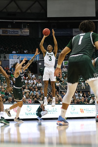 Colby Rogers (3) shoots over Samuta Avea (32) at the Stan Sheriff Center, Honolulu, Hawaii on January 16, 2020. Rogers led Cal Poly with 18 points.
