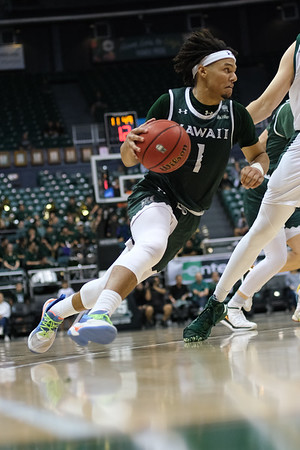 Drew Buggs doesn't touch the floor on this drive at the Stan Sheriff Center, Honolulu, Hawaii on January 16, 2020.