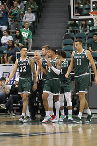 The Hawaii team heads to the bench at the Stan Sheriff Center, Honolulu, Hawaii on January 16, 2020.