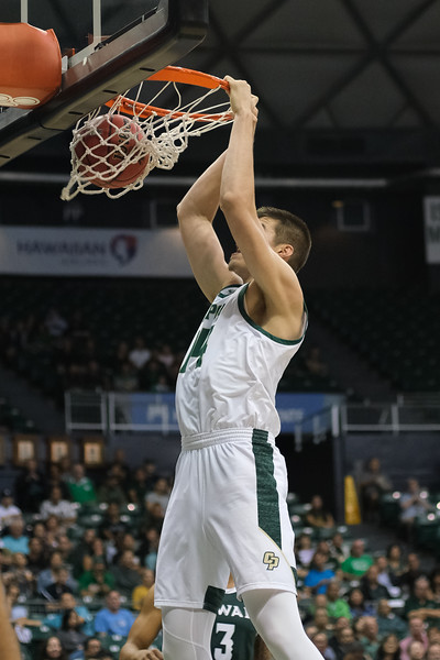 Tuukka Jaakkola finishes the pick and roll with a dunk at the Stan Sheriff Center, Honolulu, Hawaii on January 16, 2020.