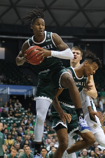 Justin Hemsley (42) comes down with a rebound at the Stan Sheriff Center, Honolulu, Hawaii on January 16, 2020.