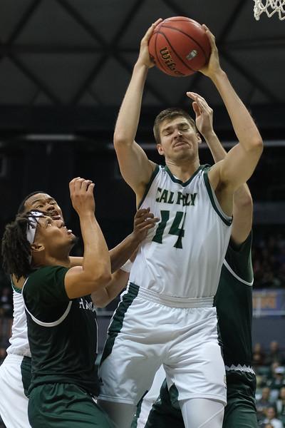 Tuukka Jaakkola comes down with the board at the Stan Sheriff Center, Honolulu, Hawaii on January 16, 2020. Jaakkola had 4 rebounds on the night.