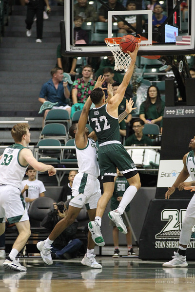 Samuta Avea (32) drives for a layup against Cal Poly at the Stan Sheriff Center, Honolulu, Hawaii on January 16, 2020.