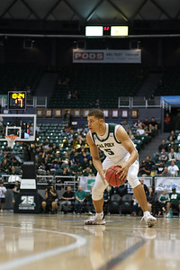 Mark Crowe (5) of Cal Poly looks to drive against Hawaii at the Stan Sheriff Center, Honolulu, Hawaii on January 16, 2020.