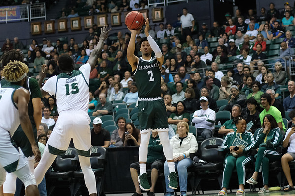Justin Webster shoots from the wing at the Stan Sheriff Center, Honolulu, Hawaii on January 16, 2020. Webster came off the bench to contribute 9 points.