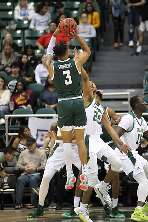Hawaii guard Eddie Stansberry (3) shoots over the defense of Cal Poly's Jamal Smith (25) at the Stan Sheriff Center, Honolulu, Hawaii on January 16, 2020.